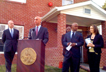 Mayor Adrian M. Fenty speaks in front of the Wanda Alston House