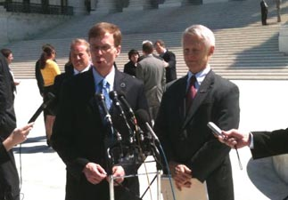 Washington Attorney General Rob McKenna (R), left, and Secretary of State Sam Reed (R) talk to reporters after the oral arguments were held at the U.S. Supreme Court in Doe #1 v. Reed.