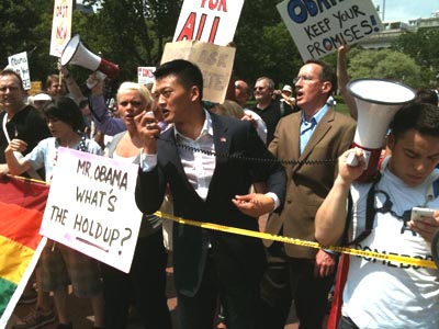 Lt. Daniel Choi speaks at May 2 Get Equal rally, with James Pietrangelo behind him