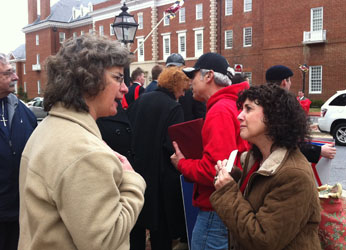 An opponent of the marriage bill (L) argues with a supporter outside Maryland State House