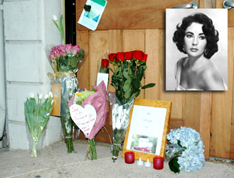 Flowers left for Taylor in front of the Elizabeth Taylor Center
