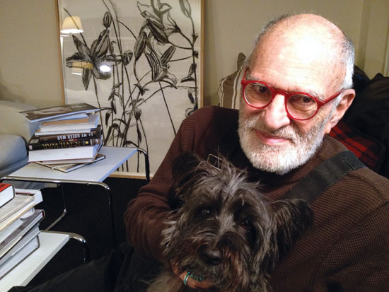 Larry Kramer, with his dog Charley, in his Manhattan home