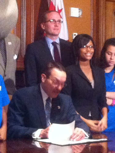 Mayor Vincent Gray (seated) signs Youth Bullying Prevention Act of 2012 into law