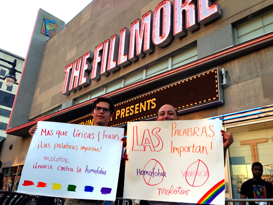 LGBT activists hold up signs protesting violent anti-gay lyrics of the Mexican rock band Molotov outside the band's concert Monday night at the Fillmore Silver Spring.
