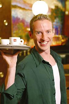 Work it, girl: gay waiter Topher.