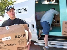 Kirsten Feyling of Food and Friends unloads meals at the DC Armory. Photo by Photo courtesy Food & Friends