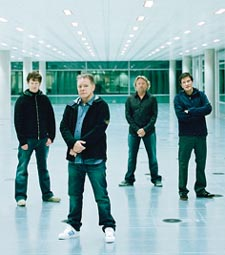 New Order with Bernard Sumner (center left) and Peter Hook (center right)