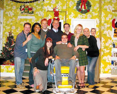 Evans (back row, fourth from left) and Hayes (center, seated) with the cast of Shear Madness Photo by Courtesy the Kennedy Center