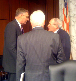 Gen. John J. Sheehan (Ret.), left, speaks with Senate Armed Services Committee Chairman Carl Levin (D-Mich.), right, following a committee hearing on Thursday, March 18, about the ''Don't Ask, Don't Tell'' policy. Photo by Chris Geidner