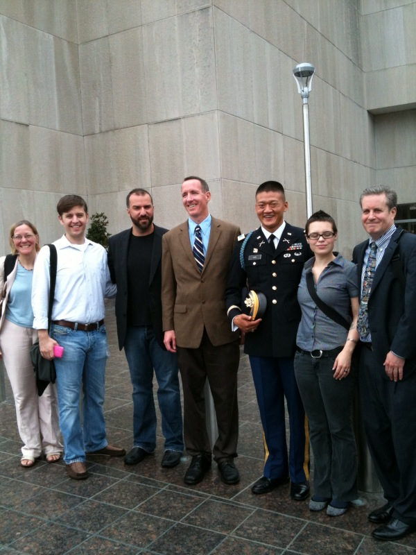 The team of lawyers and Get Equal activists pose for a picture with Lt. Dan Choi and James Pietrangelo following the dismissal on Wednesday of the two men's charges stemming from their White House protests. trialteam071410.jpg