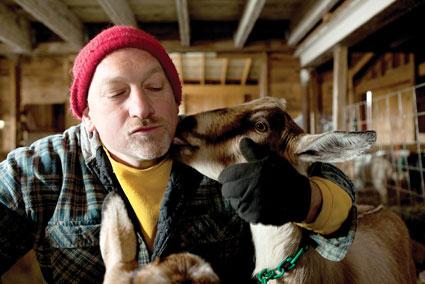 Farmer John with Goats Photo by Joao Canziani