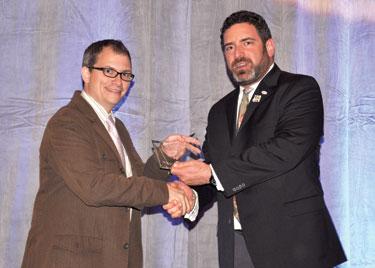 Chris Geidner receives award from NLGJA President David Steinberg Photo by Scott A. Drake