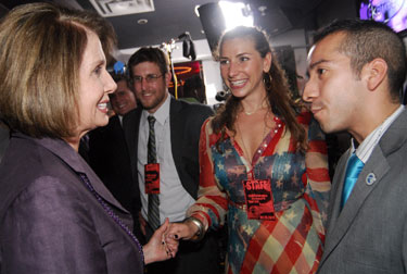 House Minority Leader Nancy Pelosi (D-Calif.) talks with Danny Hernandez at the Servicemembers Legal Defense Network event celebrating the repeal of ''Don't Ask, Don't Tell.'' Photo by Ward Morrison