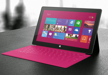 Microsoft Surface with magenta cover Photo by