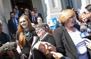 Photo: Plaintiffs Mary Townley (right), Carol Schall and their daughter Emily. Credit: AFER.