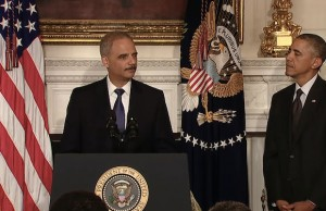 Image: Eric Holder announces his resignation.