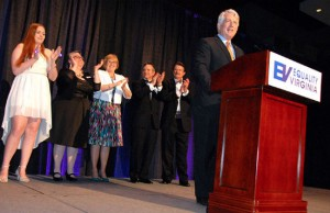 Va. Attorney General Mark Herring addresses Equality Virginia's 12th Annual Commonwealth Dinner (April 2015), surrounded by the lead plaintiffs in the cases that helped overturn Virginia's ban on same-sex marriage.
