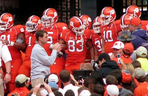 Clemson coach Dabo Swinney and the Tigers following their 2008 matchup against Duke University (Photo credit: Lauren Nelson, via Wikimedia Commons).