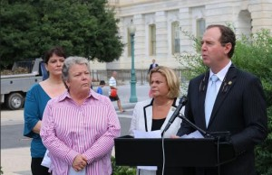 U.S. Reps. Adam Schiff (far right) and Ileana Ros-Lehtinen (right) speak at a press conference. Also pictured are, from left to right, Jodi Hobbs, president of the Survivors of Institutional Abuse Organization, and Lorri Jean, CEO of the Los Angeles LGBT Center. (Credit: Tess Whittlesey, Office of Congressman Adam Schiff)