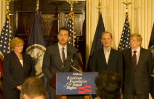 AFER Executive Director Adam Umhoefer (center) at a press conference, flanked by plaintiffs in Virginia's marriage equality case, along with lawyers David Boies and Ted Olson (right).  (Credit: Diana Walker/AFER.)