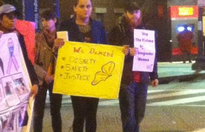 Demonstrators holding signs block the street at the Trans Day of Action demonstration. The demonstration was to call attention to anti-trans violence, police brutality and mistreatment of transgender women, and to call for the end of detention and deportation of transgender immigrants.  John Riley