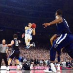 University of North Carolina's Marcus Paige shoots a 3-pointer durinng the 2016 NCAA Championship Game against Villanova (Photo: James W. Neal, via Wikimedia).