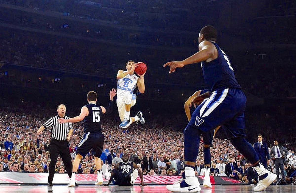 University of North Carolina's Marcus Paige shoots a 3-pointer durinng the 2016 NCAA Championship Game against Villanova - Photo: James W. Neal, via Wikimedia.