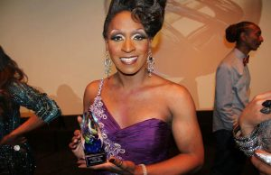Vincent Hill as Vicki Voxx with his 2012 PRISM Award. Photo from Vincent Hill's Facebook page.