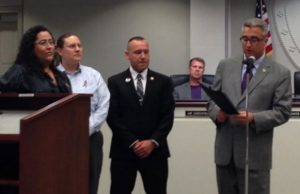 Fairfax City Mayor Scott Silverthorne reads aloud a proclamation he will present to members of Northern VA Pride recognizing June as LGBT Pride Month (Photo: Northern VA Pride, via Facebook).