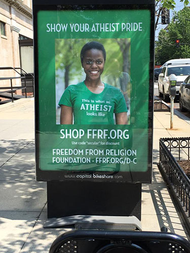 """""""This is what an Atheist looks like"""" reads the t-shirt in a FFRF poster, one of many similar ads spread throughout DC ahead of the Reason Rally - Photo: JD Uy"""