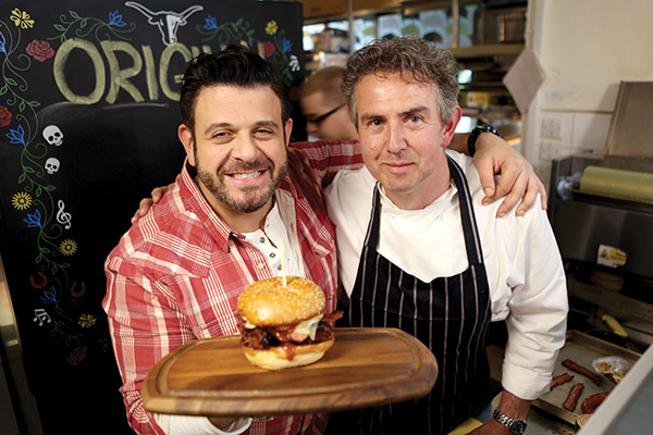 Adam Richman and the off menu Matambrito a la Pizza at Lo de Freddy parrilla -- Photo courtesy of Travel Channel