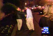 Kensinger and Pesavento (left) during an attack caught on camera by WJLA