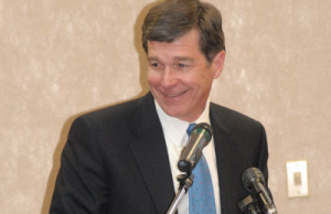 North Carolina Attorney General Roy Cooper (Photo: Airman 1st Class Mindy Bloem, via Wikimedia).