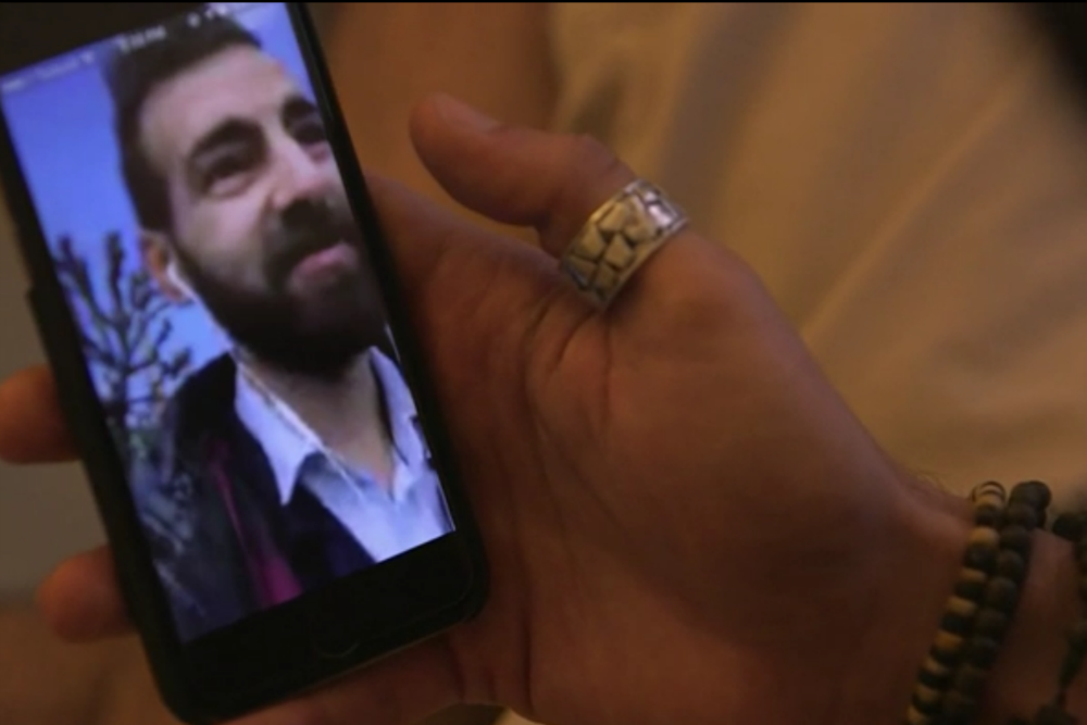 Ahmed and Josepg use Skype to see one another, Credit: BBC News