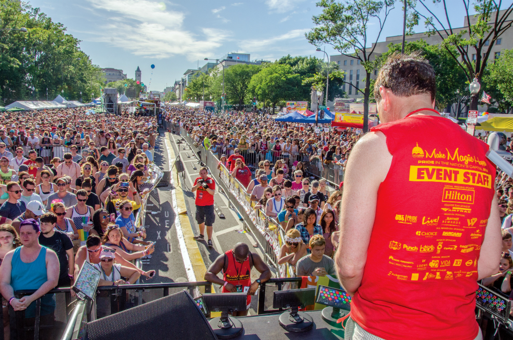 Bernie Delia leads a moment of silence for the Orlando Victims at Capital Pride Festival - Photo: Randy Shulman