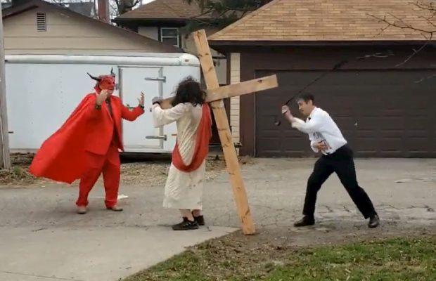 Anti-gay protestor dressed as Pete Buttigieg whips Jesus while Satan watches
