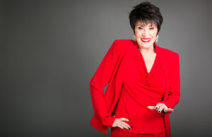 Chita Rivera in red
