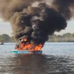 The burning boat, after its occupants allegedly harassed a group flying Pride flags
